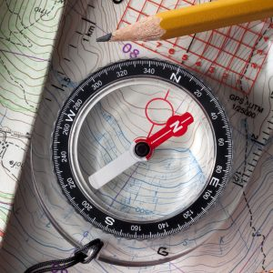 Compass on topographic maps wtih rope climbing and pencil.Similar photographs from my portfolio:
